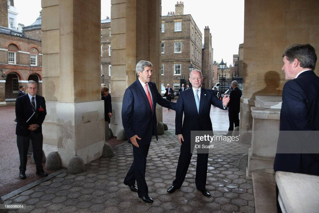 US Secretary of State <a gi-track='captionPersonalityLinkClicked' href=/galleries/search?phrase=John+Kerry&family=editorial&specificpeople=154885 ng-click='$event.stopPropagation()'>John Kerry</a> (C) is greeted by British Foreign Secretary <a gi-track='captionPersonalityLinkClicked' href=/galleries/search?phrase=William+Hague&family=editorial&specificpeople=206295 ng-click='$event.stopPropagation()'>William Hague</a> (2nd R) as he arrives to attend a meeting of the 'London 11' collective of foreign ministers, from the Friends of Syria Core Group, in Lancaster House on October 22, 2013 in London, England. The meeting, hosted by British Foreign Secretary <a gi-track='captionPersonalityLinkClicked' href=/galleries/search?phrase=William+Hague&family=editorial&specificpeople=206295 ng-click='$event.stopPropagation()'>William Hague</a>, brings together Foreign Ministers from: the USA, Egypt, France, Germany, Italy, Jordan, Qatar, Saudi Arabia, Turkey and UAE as well as representatives from the Syrian National Coalition.