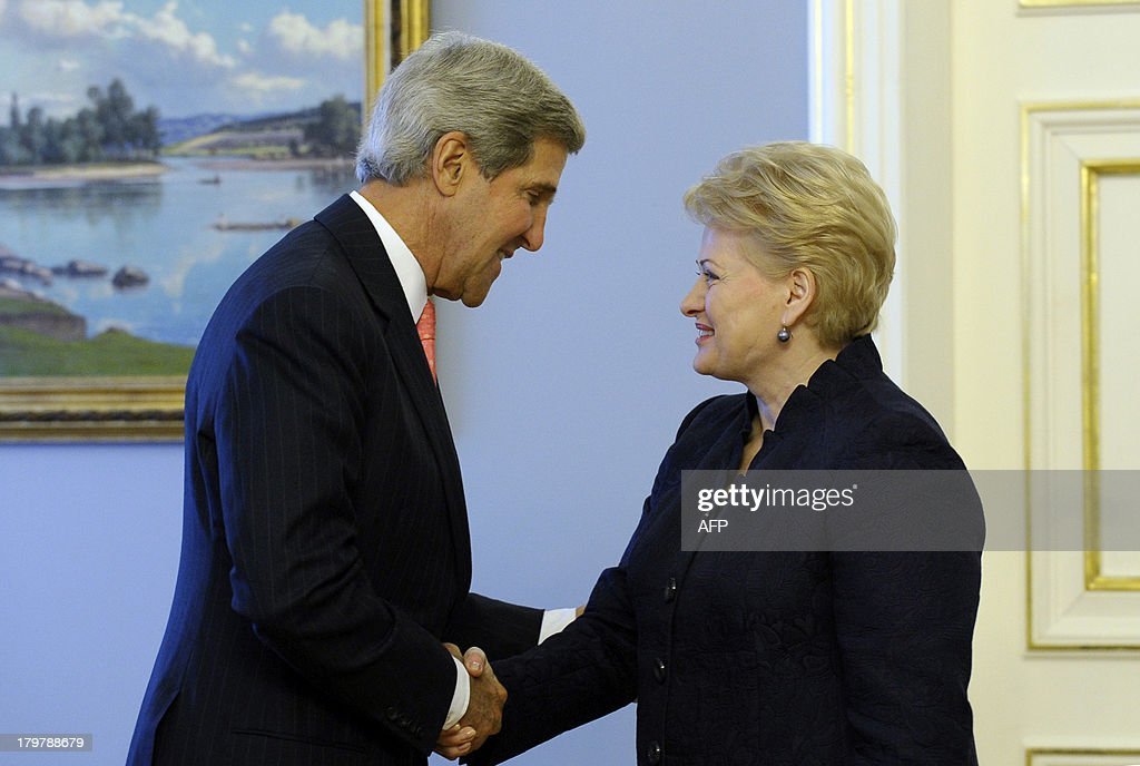 US Secretary of State John Kerry (L) is greeted by Lithuanian President Dalia Grybauskaite on September 7, 2013 at the Presidential Palace in Vilnius. Kerry sought to muster European Union support for military strikes against Syria, after a G20 summit failed to resolve bitter international divisions on the issue. Washington's top diplomat went into informal talks with the EU's 28 foreign ministers in Lithuania, which currently holds the EU's rotating chair, with the bloc itself sharply split on Syria and most nations highly reticent over military action.