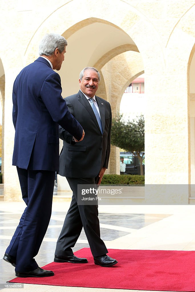 U.S. Secretary of State John Kerry (L) is received by his Jordanian counterpart Nasser Judeh upon his arrival at the royal palace November 7, 2013 in Amman, Jordan. Kerry met with King Abdullah II and Foreign Minister Nasser Judeh in Jordan after previously meeting with Israeli and Palestinian leaders during a trip to the Middle East in an effort to boost Israeli-Palestinian peace talks.