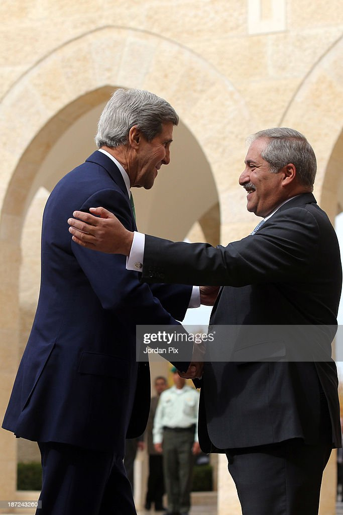 U.S. Secretary of State <a gi-track='captionPersonalityLinkClicked' href=/galleries/search?phrase=John+Kerry&family=editorial&specificpeople=154885 ng-click='$event.stopPropagation()'>John Kerry</a> (L) is received by his Jordanian counterpart <a gi-track='captionPersonalityLinkClicked' href=/galleries/search?phrase=Nasser+Judeh&family=editorial&specificpeople=3465453 ng-click='$event.stopPropagation()'>Nasser Judeh</a> upon his arrival at the royal palace November 7, 2013 in Amman, Jordan. Kerry met with King Abdullah II and Foreign Minister <a gi-track='captionPersonalityLinkClicked' href=/galleries/search?phrase=Nasser+Judeh&family=editorial&specificpeople=3465453 ng-click='$event.stopPropagation()'>Nasser Judeh</a> in Jordan after previously meeting with Israeli and Palestinian leaders during a trip to the Middle East in an effort to boost Israeli-Palestinian peace talks.