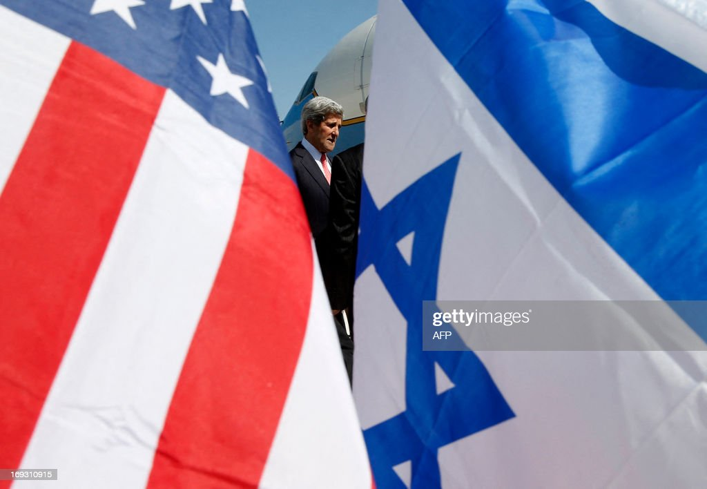 US Secretary of State John Kerry is seen between American and Israeli flags as he arrives in Tel Aviv on May 23 as he keeps up a push to bring...