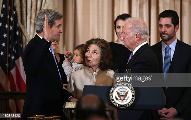 S Secretary of State John Kerry is sworn in by Vice President Joseph Biden as Kerry's wife Teresa Heinz holds a bible during a ceremonial swearing in...