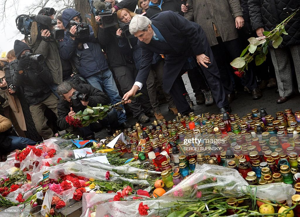 US Secretary of State John Kerry lays red roses to the Shrine of the Fallen, an homage to anti-government protesters who died during the February clashes with anti-riot policemen in Kiev, on March 4, 2014. US Secretary of State John Kerry arrived in Kiev Tuesday for talks with Ukraine's new interim government, amid an escalating crisis in Crimea. His visit came as the United States said it would provide $1 billion to financially-stricken Ukraine as part of an international loan.