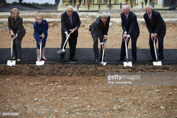 Secretary of State John Kerry leads former secretaries of state Hillary Clinton Madeleine Albright Henry Kissinger James Baker and Colin Powell in a...