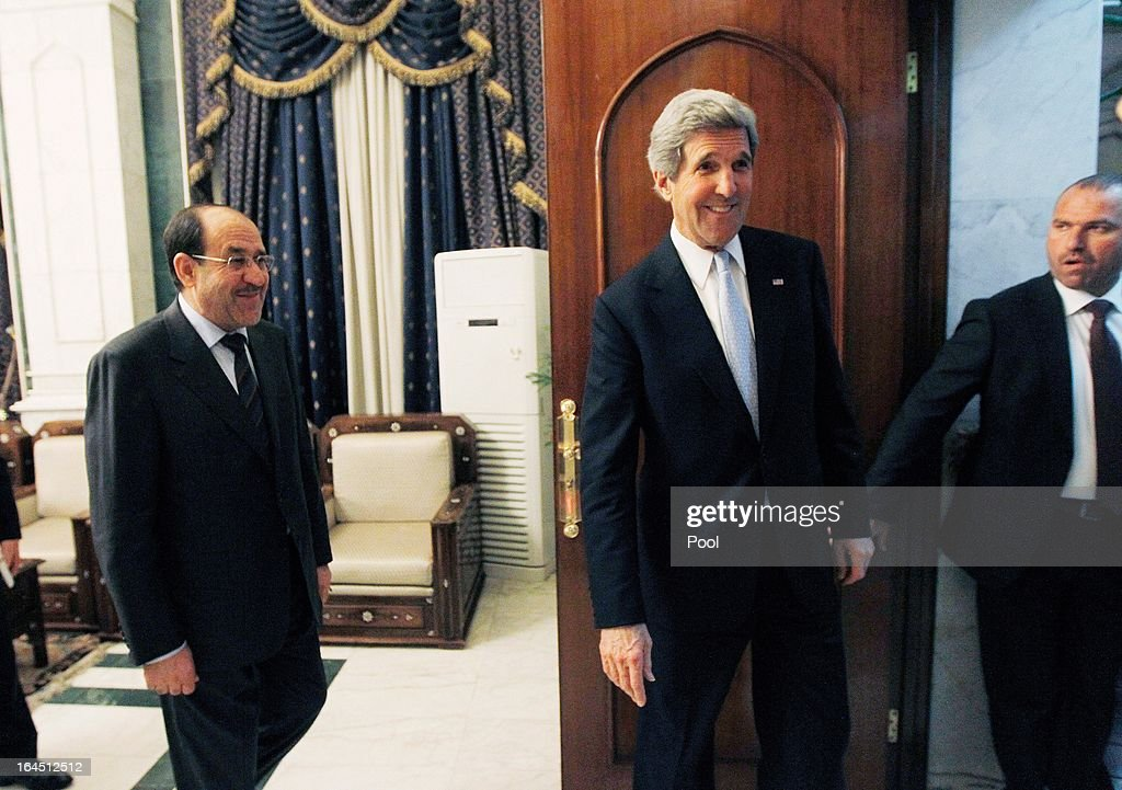 U.S. Secretary of State <a gi-track='captionPersonalityLinkClicked' href=/galleries/search?phrase=John+Kerry&family=editorial&specificpeople=154885 ng-click='$event.stopPropagation()'>John Kerry</a> leaves a meeting with Iraqi Prime Minister Nouri al-Maliki on March 24, 2013 in Baghdad. Kerry is understood to have urged Iraqi Prime Minister Nuri al-Maliki to ensure that Iranian flights over Iraq do not carry arms and fighters to Syria.