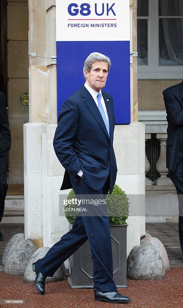 US Secretary of State John Kerry leaves the venue for a walk in Green Park during a break in the G8 Foreign Ministers meeting in central London on April 11, 2013. G8 foreign ministers including US Secretary of State John Kerry held a second day of talks in London with the crisis on the Korean peninsula and the Syrian conflict topping the agenda.