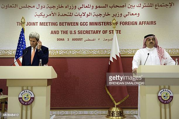 US Secretary of State John Kerry listens as Qatari Foreign Minister Khalid bin Mohammad AlAttiyah speaks during a press conference following a...