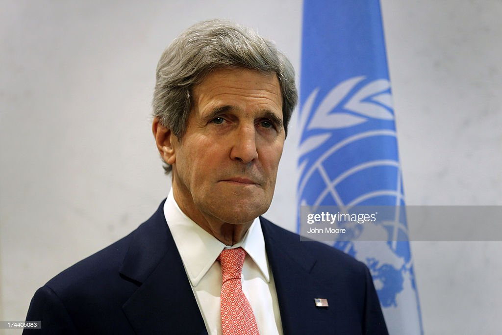 U.S. Secretary of State <a gi-track='captionPersonalityLinkClicked' href=/galleries/search?phrase=John+Kerry&family=editorial&specificpeople=154885 ng-click='$event.stopPropagation()'>John Kerry</a> listens as UN Secretary General Ban Ki-moon speaks before a meeting of the UN Security Council on July 25, 2013 in New York City. At the meeting Kerry expressed American support for the the Secretary General's Peace, Security and Cooperation Framework for the Democratic Republic of the Congo and the region.