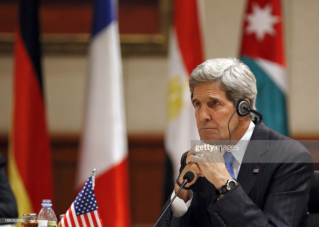 US Secretary of State John Kerry listens during the 'Friends of Syria' meeting in Amman, Jordan on May 22, 2013. The gathering seeks to discuss US-Russian proposal to hold a peace conference dubbed 'Geneva 2' to bring together rebels and representatives of Syrian President's regime.