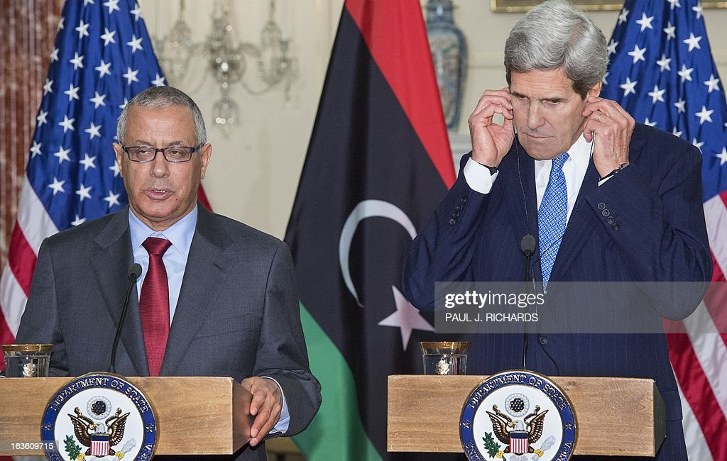 US Secretary of State John Kerry listens on translation headsets as Libyan Prime Minister Ali Zeidan(L), delivers remarks to the media after their private bilateral meeting March 13, 2013, at the US Department of State in Washington, DC. AFP Photo/Paul J. Richards