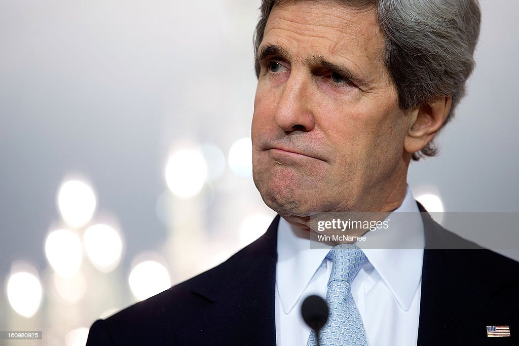 U.S. Secretary of State <a gi-track='captionPersonalityLinkClicked' href=/galleries/search?phrase=John+Kerry&family=editorial&specificpeople=154885 ng-click='$event.stopPropagation()'>John Kerry</a> listens to a question during a press conference with Canadian Foreign Minister John Baird after a bilateral meeting at the State Department February 8, 2013 in Washington, DC. Kerry said that the U.S. government continues to evaluate options to solve problematic relations with both the Syrian and Iranian governments.