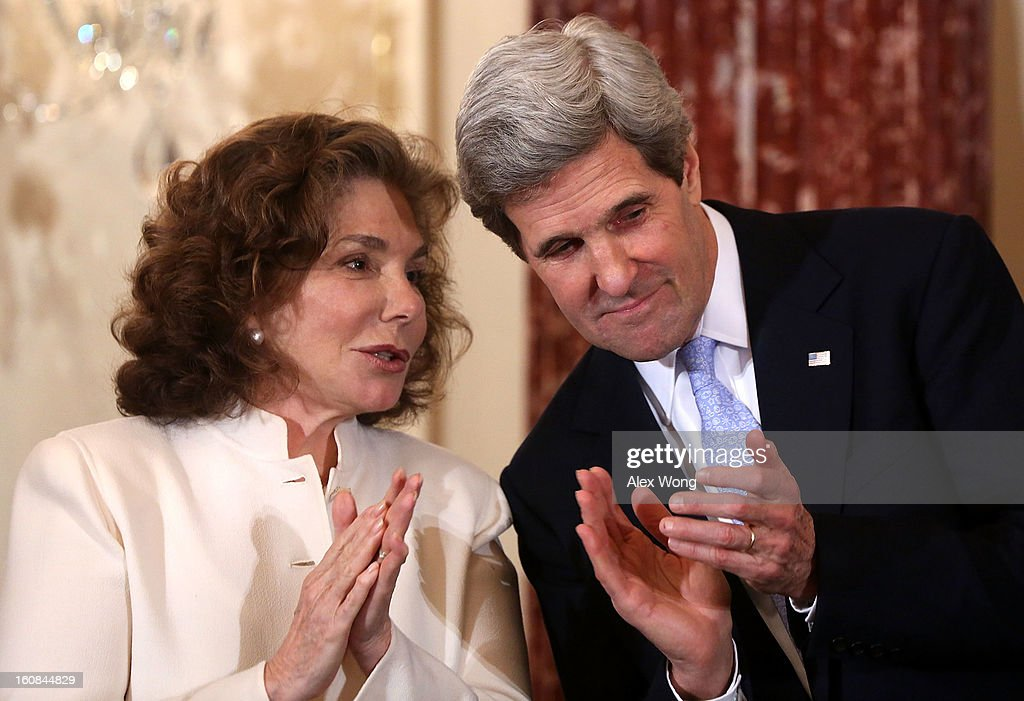 U.S. Secretary of State <a gi-track='captionPersonalityLinkClicked' href=/galleries/search?phrase=John+Kerry&family=editorial&specificpeople=154885 ng-click='$event.stopPropagation()'>John Kerry</a> (R) listens to his wife Teresa Heinz (L) during his ceremonial swearing in at the State Department February 6, 2013 in Washington, DC. Kerry was officially sworn in on February 1 at the U.S. Capitol as the 68th Secretary of State, succeeding Hillary Clinton.
