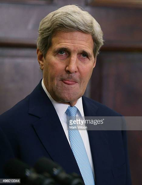 S Secretary of State John Kerry listens to US President Barack Obama's announcement to reject the Keystone XL pipeline proposal at the White House...