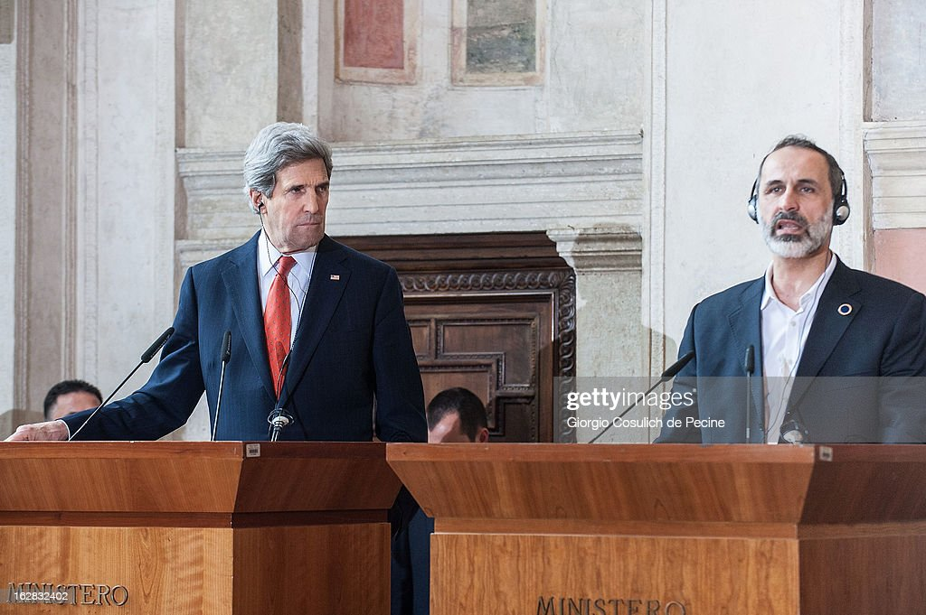 US Secretary of State John Kerry (L) listens while Syrian opposition's National Coalition chief Ahmed Moaz al-Khatib speaks during a press conference after the meeting of the 'Friends of the Syrian People' at Villa Madama on February 28, 2013 in Rome, Italy. Kerry stated that the opposition needs 'more help' in the fight against President Bashar Hafez al-Assad. The new US Secretary of State is on his first trip and is visiting nine nations in Europe and the Middle East.