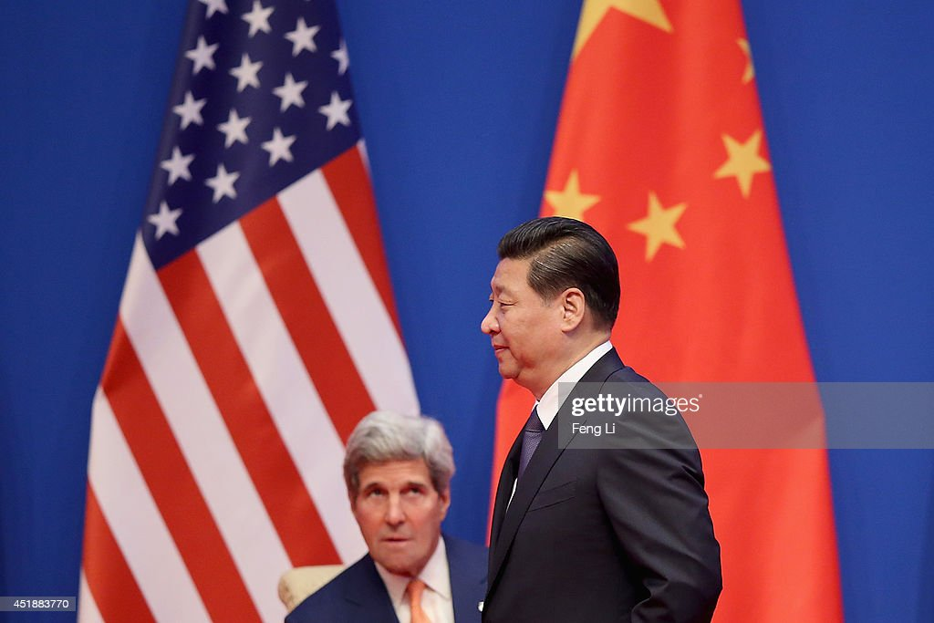 U.S. Secretary of State <a gi-track='captionPersonalityLinkClicked' href=/galleries/search?phrase=John+Kerry&family=editorial&specificpeople=154885 ng-click='$event.stopPropagation()'>John Kerry</a> (L) looks at China's President <a gi-track='captionPersonalityLinkClicked' href=/galleries/search?phrase=Xi+Jinping&family=editorial&specificpeople=2598986 ng-click='$event.stopPropagation()'>Xi Jinping</a> (R) as he makes his way to deliver a speech during the opening ceremony of the 6th China-U.S. Security and Economic Dialogue and 5th round of China-U.S. High Level Consultation on People-to-People Exchange at Diaoyutai State Guest House on July 9, 2014 in Beijing, China.