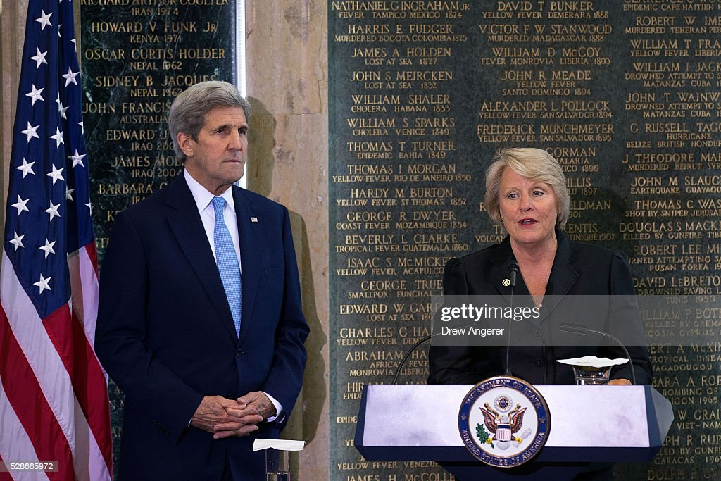U.S. Secretary of State <a gi-track='captionPersonalityLinkClicked' href=/galleries/search?phrase=John+Kerry&family=editorial&specificpeople=154885 ng-click='$event.stopPropagation()'>John Kerry</a> looks on as Barbara J. Stephenson, former Deputy Chief of Mission at the U.S. Embassy in London, delivers remarks during the American Foreign Service Association (AFSA) Memorial Plaque Ceremony for Steven Farley, at the U.S. State Department, May 6, 2016, in Washington, DC. Steven Farley, a State Department employee, died on June 4, 2008 when an improvised explosive device detonated prior to a meeting between American officials and members of the Sadr City District Council. Housed in the diplomatic lobby of the State Department, the memorial wall plaques honor diplomats who have given their lives in the line of duty.