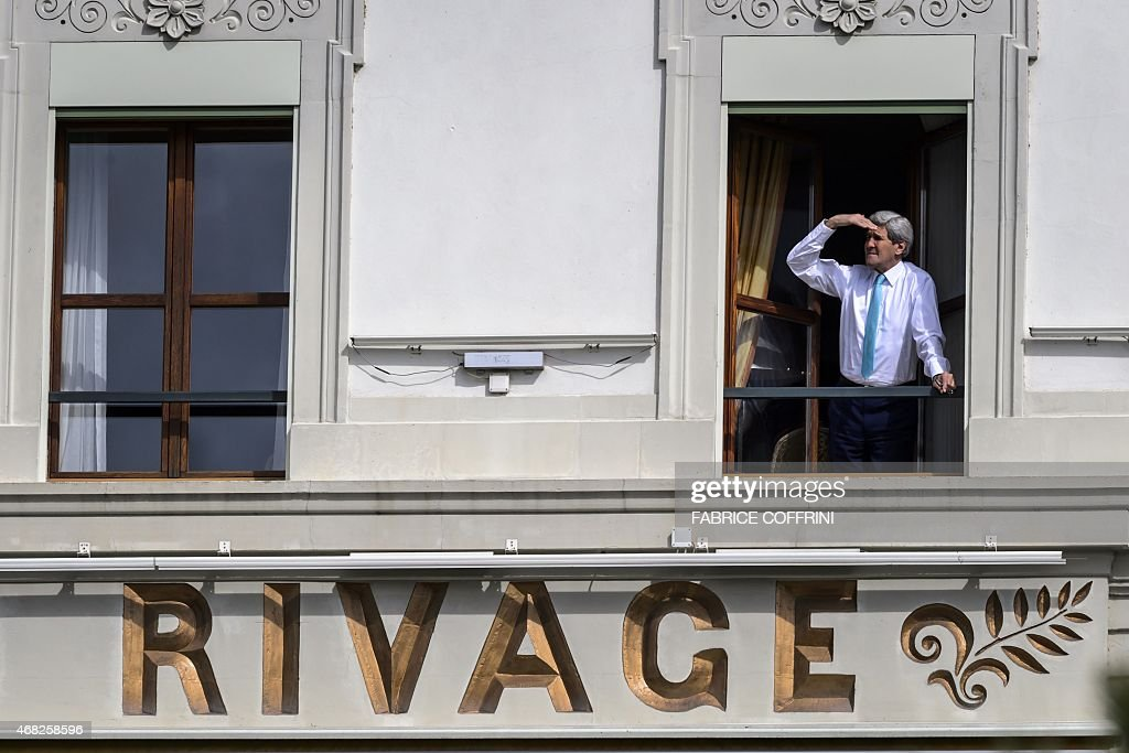 US Secretary of State John Kerry looks out of the window of his room at the BeauRivage Palace hotel during a break in Iran nuclear talks in Lausanne...