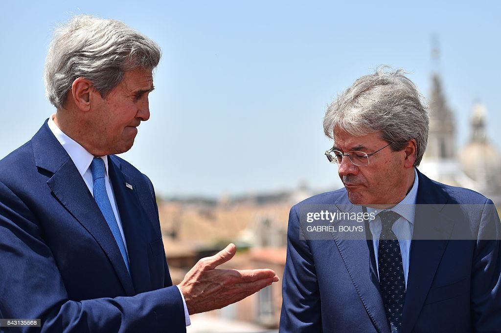 US Secretary of State John Kerry (L) meets Italian Foreign minister Paolo Gentiloni in Rome on June 26, 2016. After his visit to Rome, US Secretary of State John Kerry will fly to Brussels and London on June 27, 2016 for crisis talks with top EU and British officials in the aftermath of Britain's vote to leave the European Union. / AFP / GABRIEL