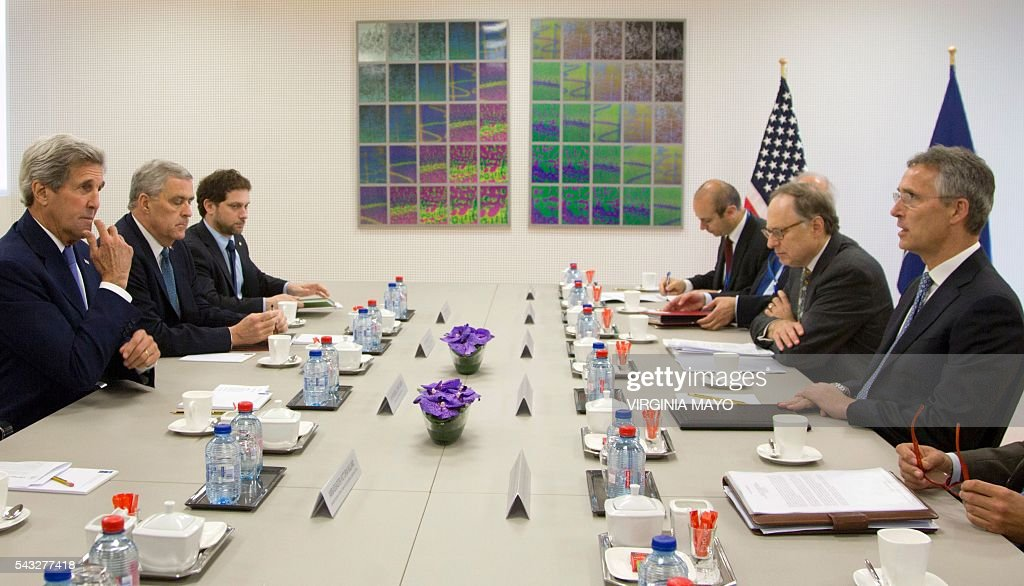 US Secretary of State John Kerry (L) meets NATO Secretary General Jens Stoltenberg at NATO headquarters in Brussels on June 27, 2016. / AFP / POOL / Virginia Mayo