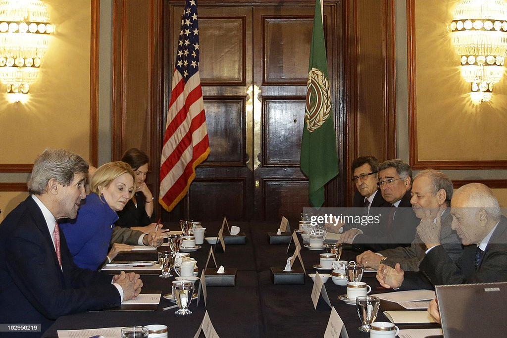U.S. Secretary of State John Kerry (L) meets with Arab League Secretary General Nabil al-Arabi (R) in Cairo, on March 2, 2013. The Egyptian capital is the sixth leg of Kerry's first official overseas trip and begins the Middle East portion of his nine-day journey. AFP PHOTO/JACQUELYN MARTIN-POOL