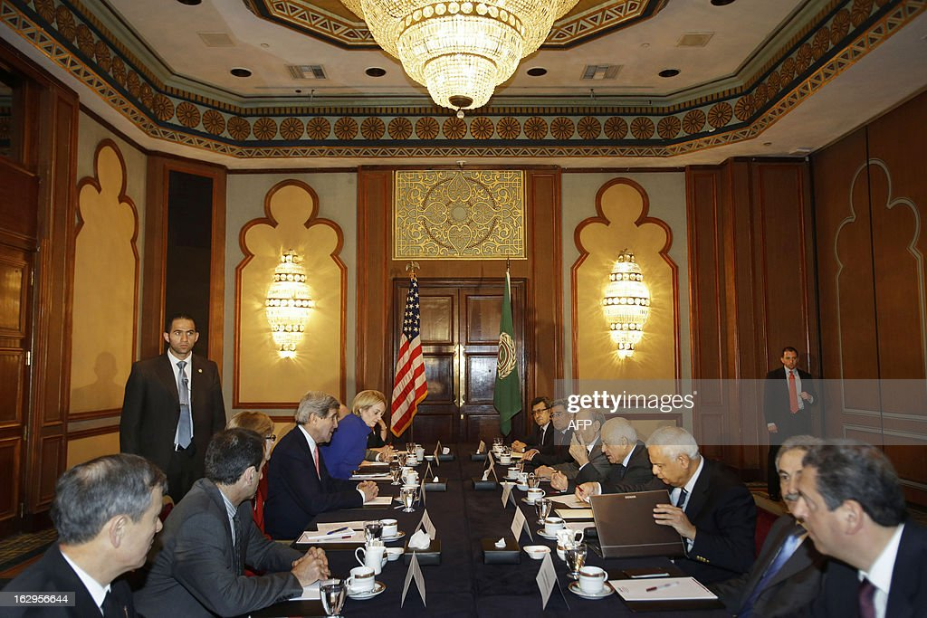U.S. Secretary of State John Kerry (4th-L) meets with Arab League Secretary General Nabil al-Arabi (4th-R) in Cairo, on March 2, 2013. The Egyptian capital is the sixth leg of Kerry's first official overseas trip and begins the Middle East portion of his nine-day journey. AFP PHOTO/JACQUELYN MARTIN-POOL