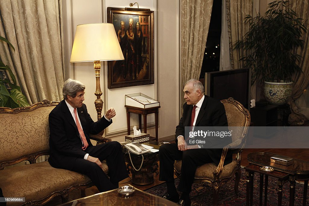 US Secretary of State John Kerry (L) meets with Egyptian Foreign Minister, Mohamed K. Amr during a meeting at the Egyptian Foreign Ministry on March 2, 2013 in Cairo, Egypt. Secretary of State Kerry is visiting Egypt for two days during an eleven country tour of Europe and the Middle East, marking the first overseas trip by Kerry since assuming the role of Secretary of State.