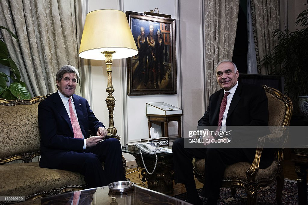 US Secretary of State John Kerry (L) meets with Egyptian Foreign Minister Mohammed Kamel Amr in Cairo on March 2, 2013. Kerry urged bickering Egyptian political leaders to forge a consensus to pave the way for aid that could help lift their country out of its deep economic crisis.