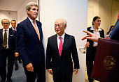 US Secretary of State John Kerry meets with IAEA Director General Yukiya Amano after the IAEA verified that Iran has met all conditions under the...