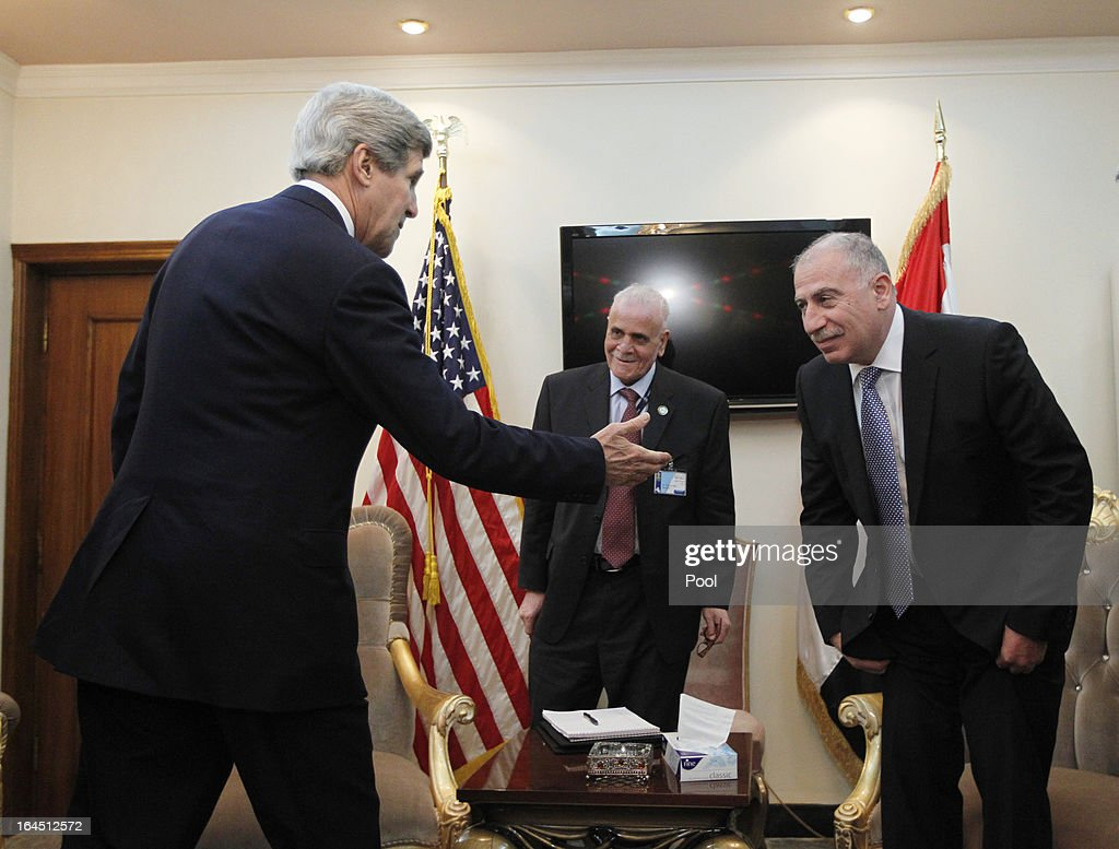 U.S. Secretary of State <a gi-track='captionPersonalityLinkClicked' href=/galleries/search?phrase=John+Kerry&family=editorial&specificpeople=154885 ng-click='$event.stopPropagation()'>John Kerry</a> (L) meets with Iraq's Parliament Speaker Osama al-Nujaifi (R) during an announced visit to the country on March 24, 2013 in Baghdad. Kerry is understood to have urged Iraqi Prime Minister Nuri al-Maliki to ensure that Iranian flights over Iraq do not carry arms and fighters to Syria.