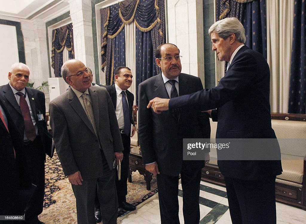 U.S. Secretary of State <a gi-track='captionPersonalityLinkClicked' href=/galleries/search?phrase=John+Kerry&family=editorial&specificpeople=154885 ng-click='$event.stopPropagation()'>John Kerry</a> (R) meets with Iraq's Prime Minister <a gi-track='captionPersonalityLinkClicked' href=/galleries/search?phrase=Nouri+al-Maliki&family=editorial&specificpeople=539622 ng-click='$event.stopPropagation()'>Nouri al-Maliki</a> on March 24, 2013 in Baghdad. According to a U.S. official, Kerry will urge Prime Minister Nuri al-Maliki to make sure Iranian flights over Iraq do not carry arms and fighters to Syria.