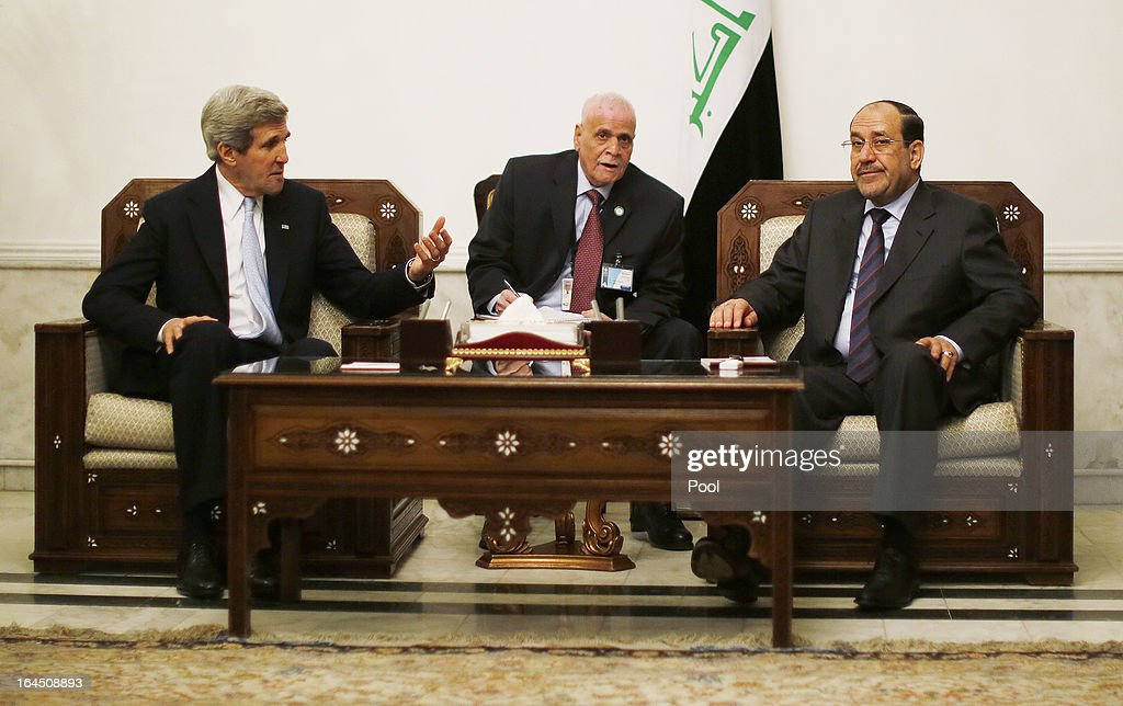 U.S. Secretary of State <a gi-track='captionPersonalityLinkClicked' href=/galleries/search?phrase=John+Kerry&family=editorial&specificpeople=154885 ng-click='$event.stopPropagation()'>John Kerry</a> meets with Iraq's Prime Minister Nouri al-Maliki on March 24, 2013 in Baghdad. According to a U.S. official, Kerry will urge Prime Minister Nuri al-Maliki to make sure Iranian flights over Iraq do not carry arms and fighters to Syria.