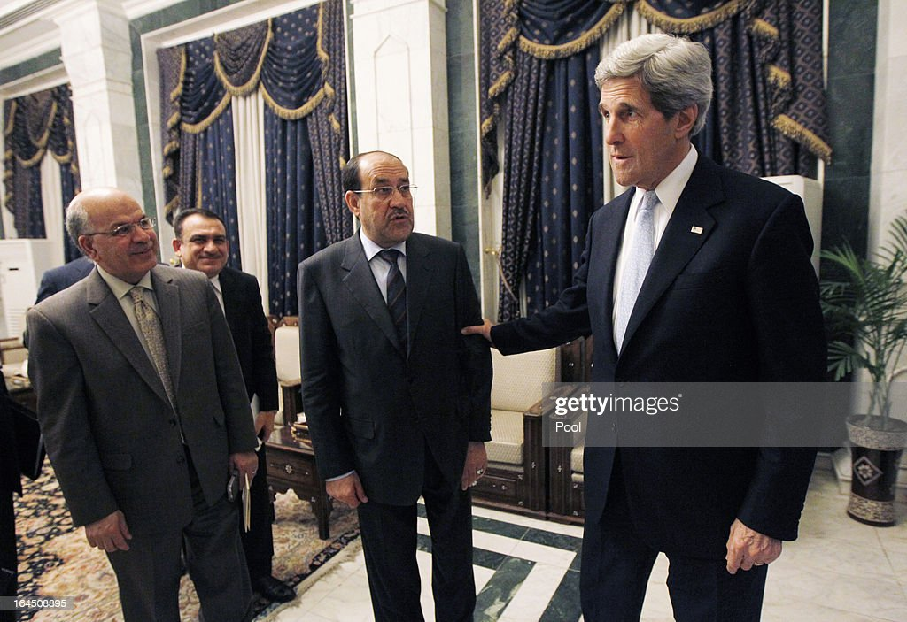 U.S. Secretary of State <a gi-track='captionPersonalityLinkClicked' href=/galleries/search?phrase=John+Kerry&family=editorial&specificpeople=154885 ng-click='$event.stopPropagation()'>John Kerry</a> meets with Iraq's Prime Minister <a gi-track='captionPersonalityLinkClicked' href=/galleries/search?phrase=Nouri+al-Maliki&family=editorial&specificpeople=539622 ng-click='$event.stopPropagation()'>Nouri al-Maliki</a> on March 24, 2013 in Baghdad. According to a U.S. official, Kerry will urge Prime Minister Nuri al-Maliki to make sure Iranian flights over Iraq do not carry arms and fighters to Syria.