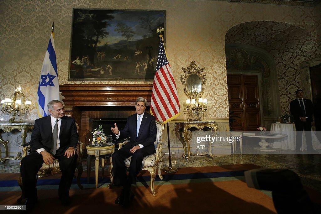 US Secretary of State John Kerry (R) meets with Israeli Prime Minister Benjamin Netanyahu at Villa Taverna, the US Ambassador's residency in Rome, on October 23, 2013. AFP PHOTO POOL / GREGORIO BORGIA