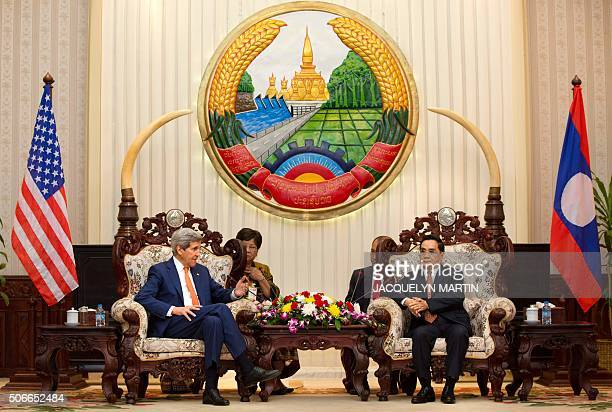 US Secretary of State John Kerry meets with Lao Prime Minister Thongsing Thammavong at the Prime Minister's Office in Vientiane on January 25 2016 US...