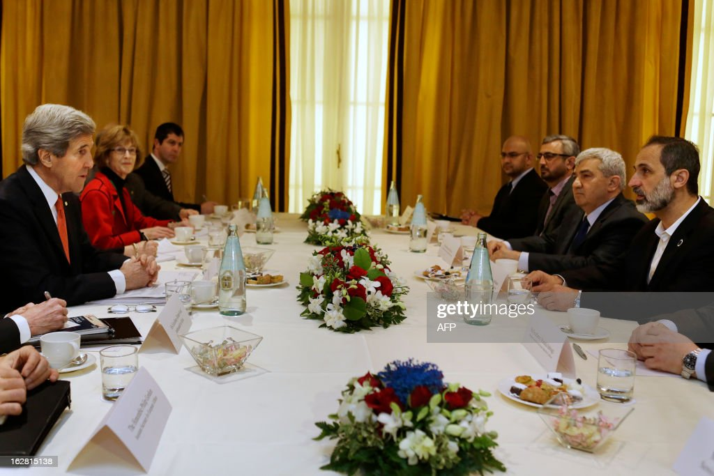 U.S. Secretary of State John Kerry (L) meets with leaders of Syrian opposition coalition leaders, President Mouaz al-Khatib (R) and Vice President Riad Seif (2ndR) at the Hotel Excelsior in Rome on February 28, 2013. Rome is the fourth leg of Kerry's first official overseas trip, a hectic nine-day dash through Europe and the Middle East.