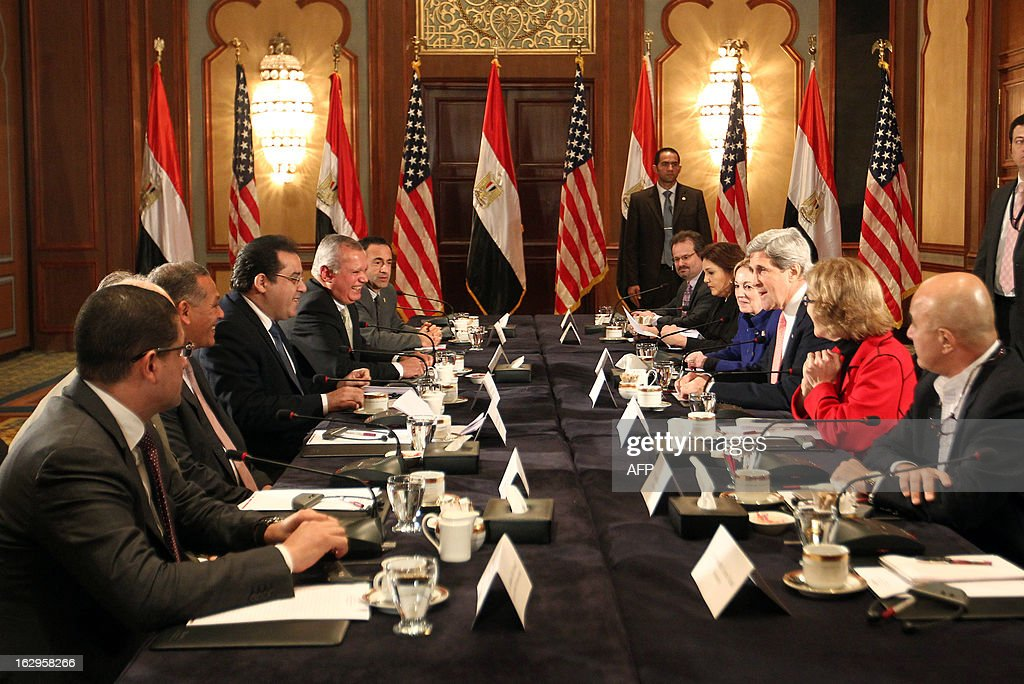 U.S. Secretary of State John Kerry (3rd-R) meets with members of Egyptian political parties including Ayman Nour (3rd-L) in Cairo, on March 2, 2013. The Egyptian capital is the sixth leg of Kerry's first official overseas trip and begins the Middle East portion of his nine-day journey. EPA