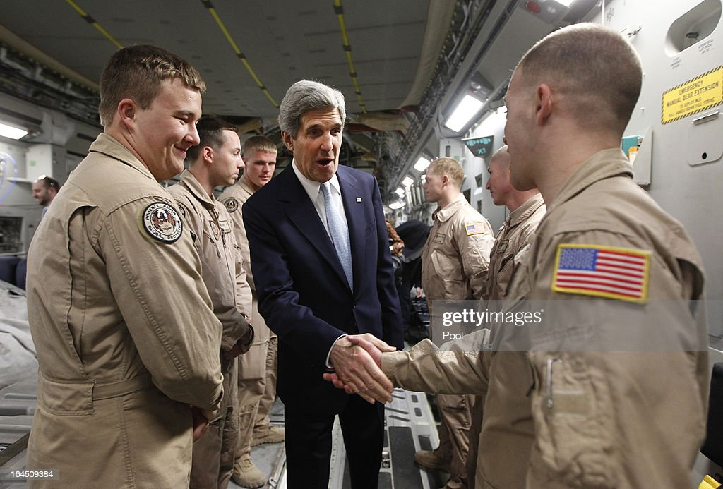 U.S. Secretary of State <a gi-track='captionPersonalityLinkClicked' href=/galleries/search?phrase=John+Kerry&family=editorial&specificpeople=154885 ng-click='$event.stopPropagation()'>John Kerry</a> meets with members of the U.S. Air Force 816 Expeditionary Airlift Squadron aboard a C-17 aircraft bound for Baghdad on March 24, 2013 in Amman, Jordan. Kerry is expected to urge Iraqi Prime Minister Nuri al-Maliki to ensure that Iranian flights over Iraq do not carry arms and fighters to Syria.