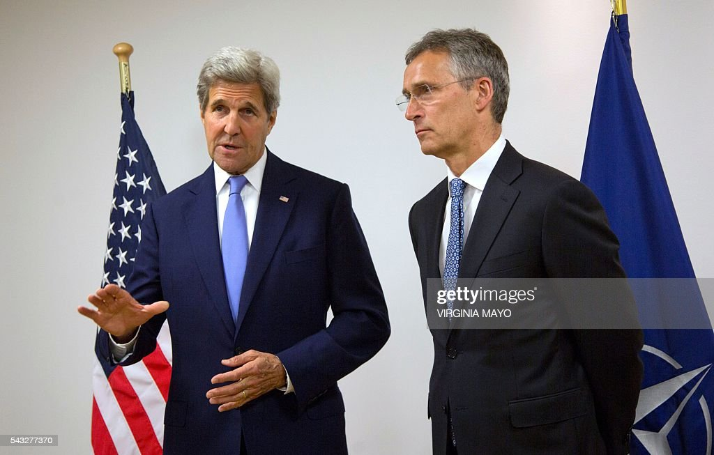 US Secretary of State John Kerry (L) meets with NATO Secretary General Jens Stoltenberg at NATO headquarters in Brussels on June 27, 2016. / AFP / POOL / Virginia Mayo
