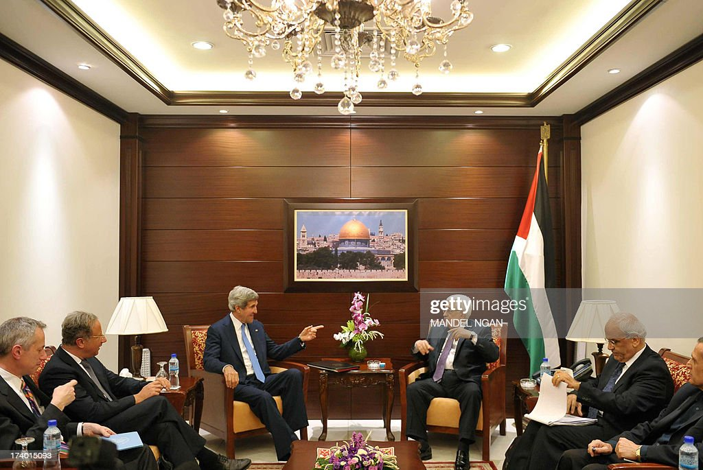 US Secretary of State John Kerry (C-L) meets with Palestinian President Mahmud Abbas (R-L) on July 19, 2013 at the Mukataa compound, in the West Bank city of Ramallah. Kerry flew by helicopter to the West Bank from Jordan to meet Palestinian president Mahmud Abbas as he battled to salvage his Middle East peace bid.
