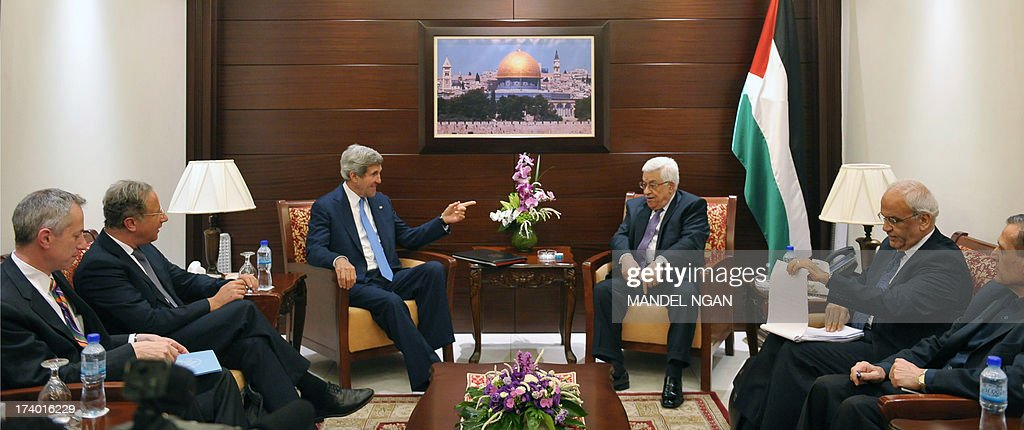 US Secretary of State John Kerry (C-L) meets with Palestinian President Mahmud Abbas (C-R) on July 19, 2013 at the Mukataa compound, in the West Bank city of Ramallah. Kerry flew by helicopter to the West Bank from Jordan to meet Palestinian president Mahmud Abbas as he battled to salvage his Middle East peace bid.