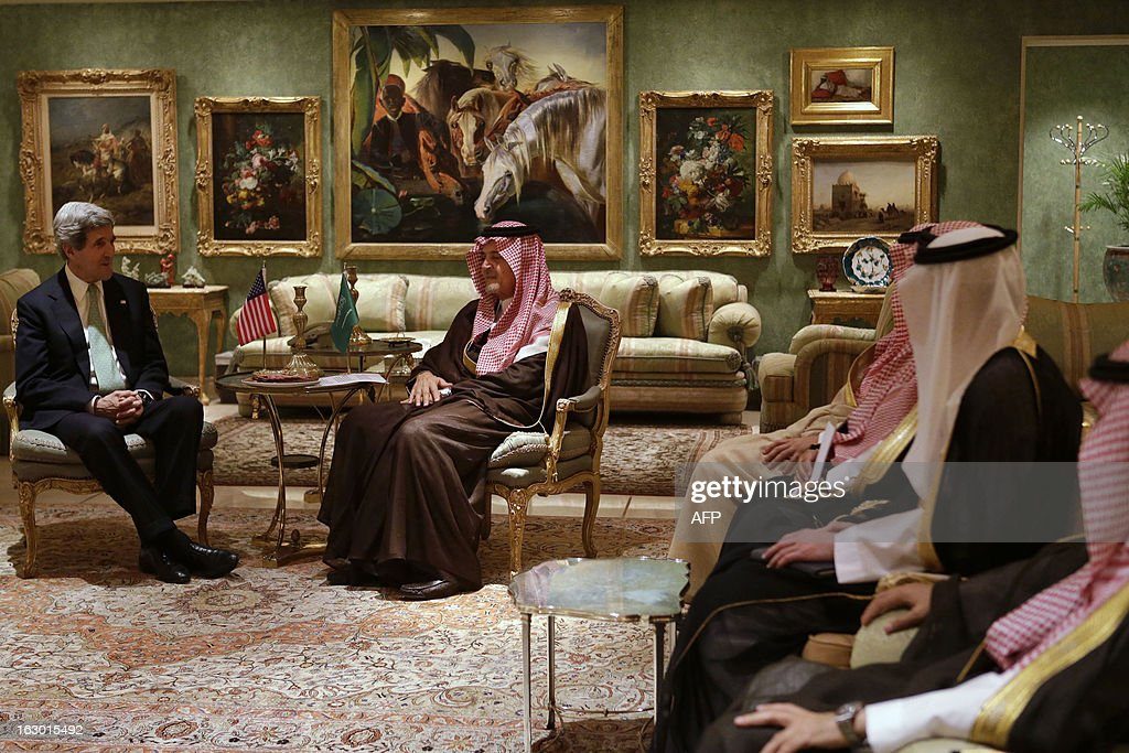 U.S. Secretary of State John Kerry (L) meets with Saudi Foreign Minister Prince Saud al-Faisal (C) in his palace in Riyadh, on March 3, 2013. Saudi Arabia is the seventh leg of Kerry's first official overseas trip. AFP PHOTO/JACQUELYN MARTIN-POOL