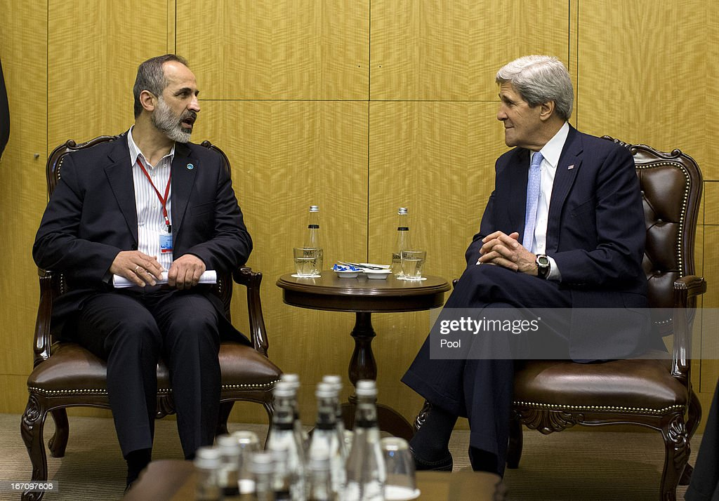 U.S. Secretary of State <a gi-track='captionPersonalityLinkClicked' href=/galleries/search?phrase=John+Kerry&family=editorial&specificpeople=154885 ng-click='$event.stopPropagation()'>John Kerry</a> meets with Syrian opposition leader Moaz al-Khatib (L) April 20, 2013 in Istanbul, Turkey. Kerry is meeting with the 'Friends of Syria' group to discuss the ongoing hostilities in Syria.