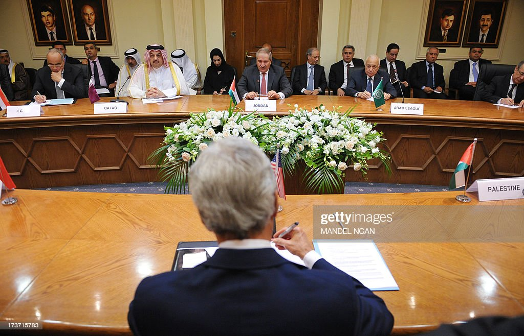 US Secretary of State John Kerry (back) meets with the Arab League Peace Initiative at the Ministry of Foreign Affairs on July 17, 2013 in Amman. Kerry is on his sixth visit to the region as he seeks to persuade the Israelis and Palestinians to resume direct negotiations frozen for almost three years.