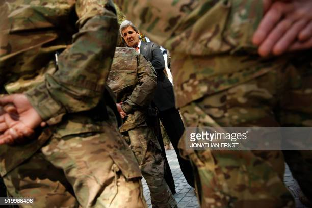 Secretary of State John Kerry meets with US military personnel at Resolute Support Headquarters in Kabul on April 9 2016 / AFP / POOL / JONATHAN ERNST