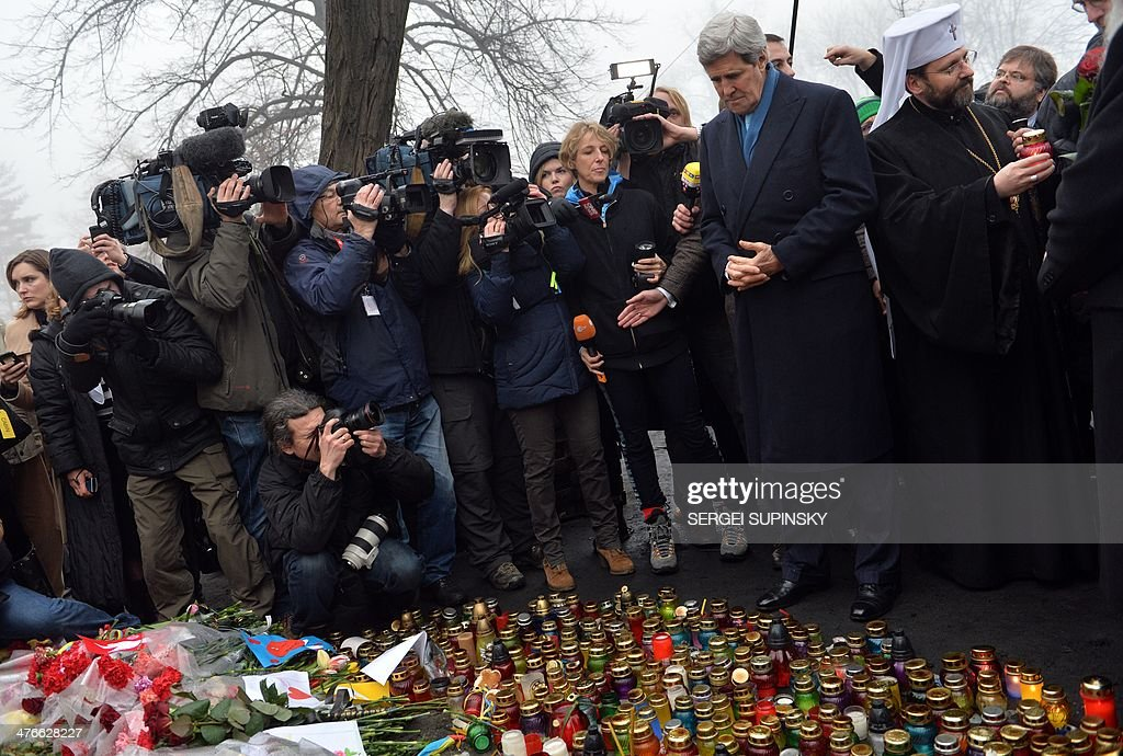 US Secretary of State John Kerry mourns in front of the Shrine of the Fallen, an homage to anti-government protesters who died during the February clashes with anti-riot policemen in Kiev, on March 4, 2014. US Secretary of State John Kerry arrived in Kiev Tuesday for talks with Ukraine's new interim government, amid an escalating crisis in Crimea. His visit came as the United States said it would provide $1 billion to financially-stricken Ukraine as part of an international loan.