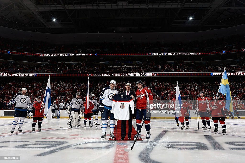 U.S. Secretary of State <a gi-track='captionPersonalityLinkClicked' href=/galleries/search?phrase=John+Kerry&family=editorial&specificpeople=154885 ng-click='$event.stopPropagation()'>John Kerry</a> participates in a ceremonial puck drop with Olympians John Carlson #74 of the Washington Capitals and <a gi-track='captionPersonalityLinkClicked' href=/galleries/search?phrase=Blake+Wheeler&family=editorial&specificpeople=716703 ng-click='$event.stopPropagation()'>Blake Wheeler</a> #26 of the Winnipeg Jets before an NHL game at Verizon Center on February 6, 2014 in Washington, DC.
