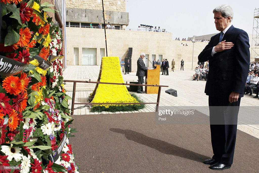 U.S. Secretary of State <a gi-track='captionPersonalityLinkClicked' href=/galleries/search?phrase=John+Kerry&family=editorial&specificpeople=154885 ng-click='$event.stopPropagation()'>John Kerry</a> pays his respect after laying a wreath during the annual ceremony for Holocaust Remembrance Day at the Yad Vashem memorial on April 8, 2013 in Jerusalem, Israel. Across the world, people commemorated the six million Jews murdered by the Nazi regime during World War II between 1933 and 1945. U.S. Secretary of State <a gi-track='captionPersonalityLinkClicked' href=/galleries/search?phrase=John+Kerry&family=editorial&specificpeople=154885 ng-click='$event.stopPropagation()'>John Kerry</a>'s visit is in an attempt to restart mideast peace talks between Israeli and Palestinians officials.