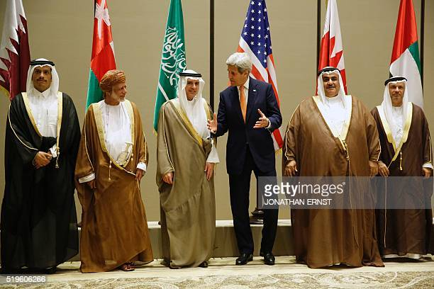 US Secretary of State John Kerry poses with a family picture with Saudi Arabia's Foreign Minister Adel alJubeir Qatar's Foreign Minister Mohammed bin...