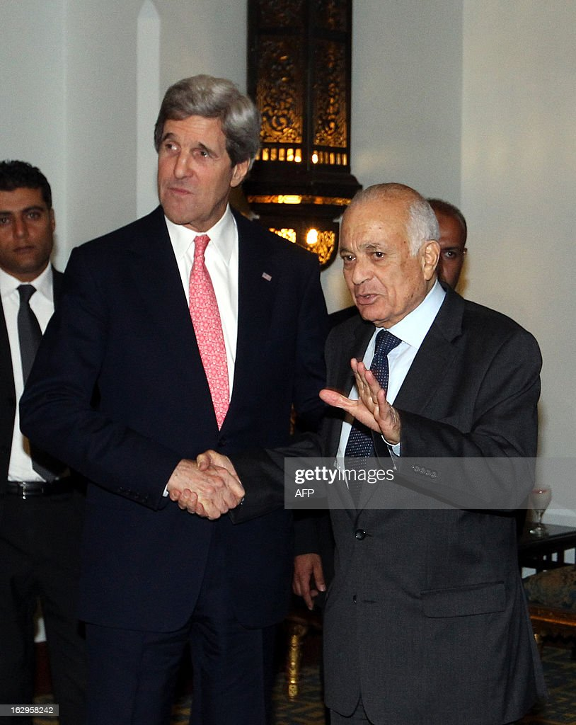 U.S. Secretary of State John Kerry (C) poses with Arab League Secretary General Nabil al-Arabi (R) after their meeting in Cairo, on March 2, 2013. The Egyptian capital is the sixth leg of Kerry's first official overseas trip and begins the Middle East portion of his nine-day journey. EPA