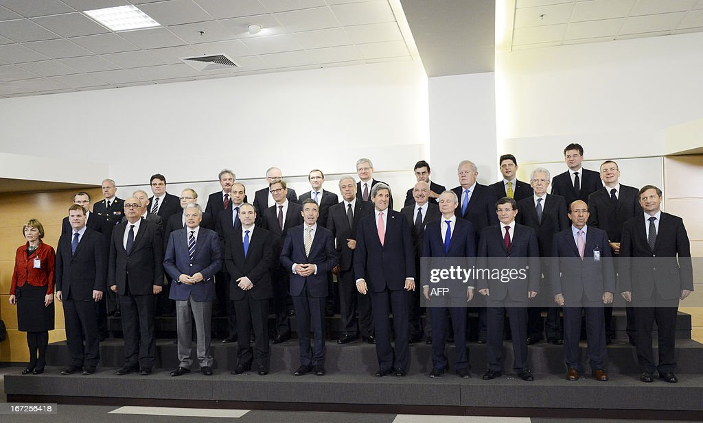 US Secretary of State John Kerry (5R front row) poses with foreign ministers for the family photo during a NATO Foreign Affairs Ministers meeting at NATO headquarter in Brussels on April 23, 2013.